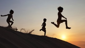 Sunset Leap on a Sand Dune